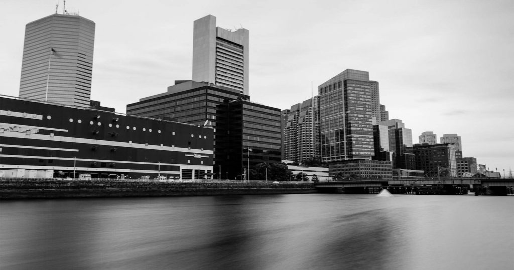 A city skyline with a silky camera affect on the river