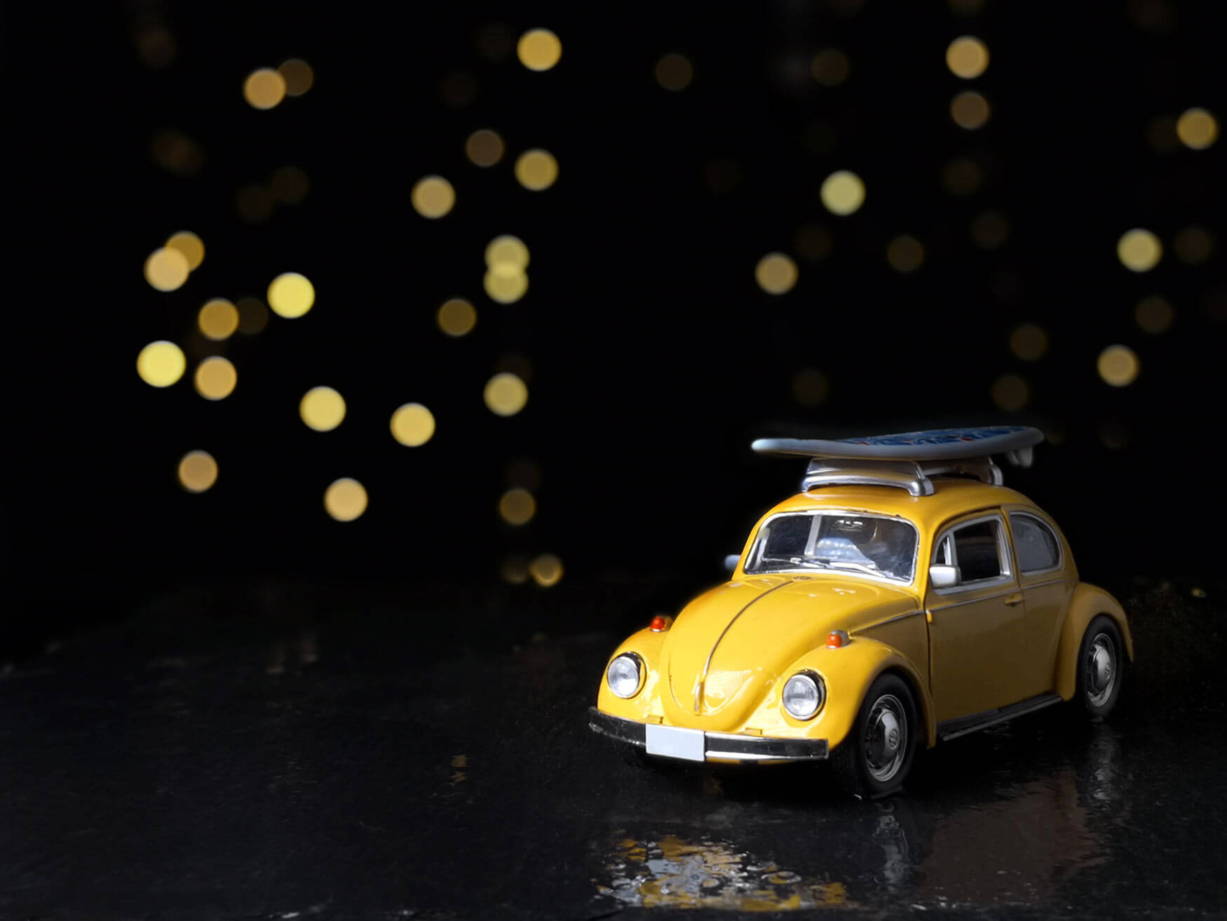 A yellow beatle toy car